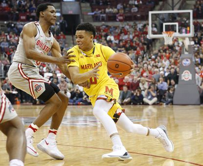 Maryland's Anthony Cowan, right, drives to the basket against Ohio State's C.J. Jackson during the first half of an NCAA college basketball game, Tuesday, Jan. 31, 2017, in Columbus, Ohio.
