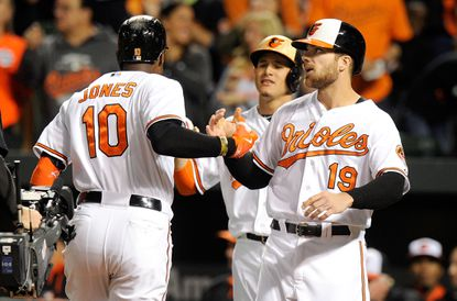 Orioles' Adam Jones (10) celebrates with Chris Davis (19) and Manny Machado after hitting a three-run home run in the first inning against the Kansas City Royals at Camden Yards on Sept. 13, 2015 in Baltimore.