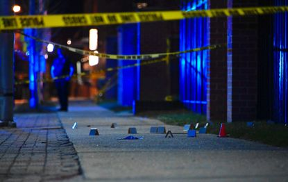 Evidence markers at a crime scene in Baltimore's Madison Park neighborhood Tuesday night.