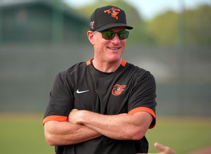 Guest coach and former Oriole Jeff Conine looks on during the first full-squad workout at the Ed Smith Stadium complex on February 17, 2020.