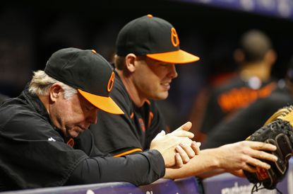 Orioles manager Buck Showalter stands with catcher Matt Wieters in the dugout during the second inning of a game against the Tampa Bay Rays.