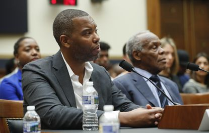 Author Ta-Nehisi Coates, left, and Actor Danny Glover, right, testify about reparation for the descendants of slaves during a hearing before a House subcommittee Wednesday.