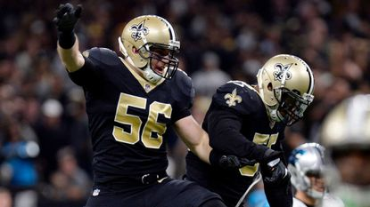 Saints linebacker Michael Mauti (56) celebrates with linebacker Jonathan Freeny in the second half of a game against the Panthers on Jan. 7. Mauti, 28, beat an inflammatory bowel disease that affects nearly 1 million Americans and returned to football last year.