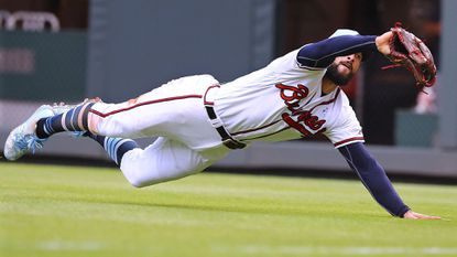 Atlanta Braves right fielder Nick Markakis makes a diving catch on a fly ball by San Diego Padres' Franmil Reyes in the ninth inning to end a 4-1 victory June 17 in Atlanta.