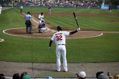 Orioles catcher Matt Wieters warms up on deck at Ed Smith Stadium during a game against the Boston Red Sox.
