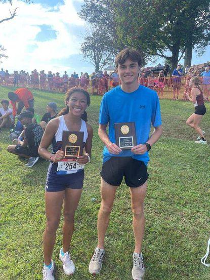 Elizabeth Pickett of Bel Air, left, and Ashton Tolson of C. Milton Wright, both captured big wins at annual Bull Run Invitational meet.