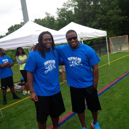 Ravens linebacker Josh Bynes (left) and New York Giants linebacker Jameel McClain at McClain's annual youth football camp at Reisterstown Regional Park.