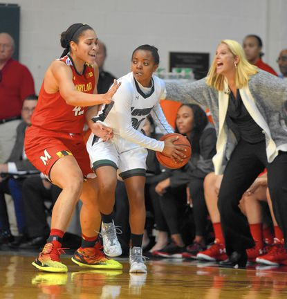 Maryland's Brionna Jones, left, defends agains Loyola's Alexis Gray in a game played Dec. 12 at Loyola's Reitz Arena.