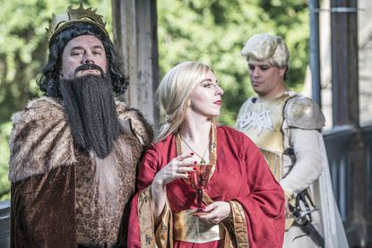 """From left: Host Ray Bullock, producer MoxieLaBouche and Dante the Inferno dress as """"Game of Thrones"""" characters for """"Burlesque is Coming."""""""