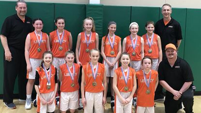 Mid Atlantic Legacy 2024 team. Front row: Ryleigh Lanza, Evangeline Hall, Summer Brooks, McKenna Lanza, Abby Rieger, coach Tim Whitehead. Back row: Coach Doug Reaves, Emma Reaves, Julianna Lesher, Gillian Blubaugh, Samantha Smith, Abby Redman, Caroline Kohr, coach Scott Kohr.