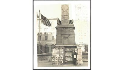 Where was Abe Sherman's original newsstand? Pictured above is Sherman at his stand in February 1942.
