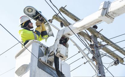 Caleb Bryant works on a utility pole in Lewiston, Maine, on Feb. 6, 2019, replacing streetlights to more energy efficient LED bulbs. Sykesville will be switching streetlights over to LED technology as well.