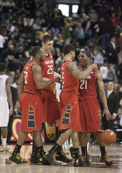 From left to right, Terps players Dez Wells, Alex Len, Nick Faust and Pe'Shon Howard celebrate in the second half against Wake Forest.