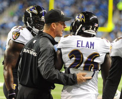 Ravens coach John Harbaugh talks with safety Matt Elam before the game in Detroit last month.