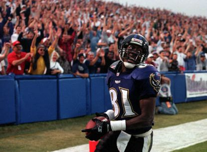 Michael Jackson celebrates his touchdown reception against the Rams on Oct. 27, 1996.
