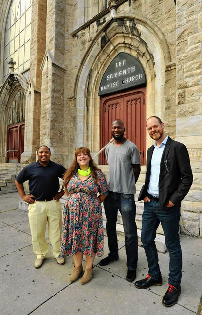 """From left, Pastor Ryan Preston Palmer of Seventh Metro Church, curator Caitlin Tucker, artist Bashi Rose, and Jeffry Cudlin, MICA professor, are all involved with """"Congregate: art + faith + community,"""" an exhibit at the MICA Graduate Studio Center that is a collaboration between artists and nearby spiritual communities."""
