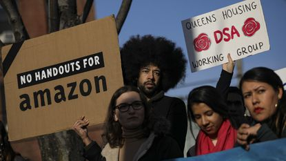 Activists and community members who opposed Amazon's plan to move into Queens rally in celebration of Amazon's decision to pull out of the deal, in the Long Island City neighborhood on Thursday in the Queens borough of New York City.