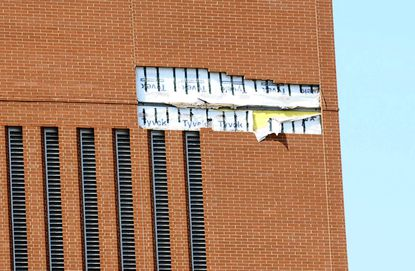 Section of brick facade falls off troubled NIH building in Baltimore