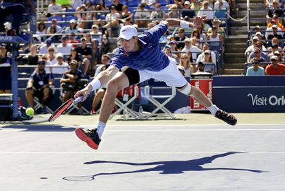 John Isner returns a shot to Jiri Vesely during the third round of the U.S. Open on Saturday.