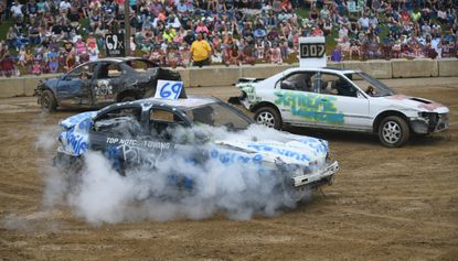 Smoke billows from the hood of a car driven by Jacob Paursen of Manchester during a 4 cylinder heat in the car demolition derby at the Carroll County 4-H & FFA Fair in Westminster on Saturday, August 7, 2021.
