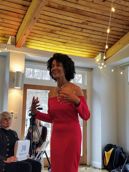 """Alice Moore-Simmons, a Bowie High School teacher, speaks at a past conference. Moore-Simmons organized the conference """"Shifting the Paradigm Back to Humanity,"""" being held Feb. 22 at Historic London Town and Gardens. - Original Credit:"""
