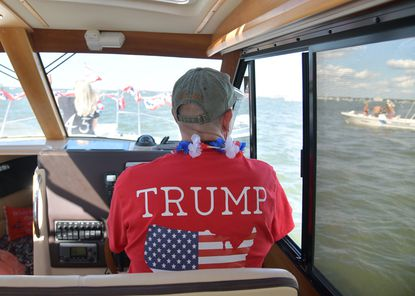 James Appel, the chair of the Anne Arundel County Republican Central Committee, drives his boat in the parade. Trump supporters from across the Maryland gathered in Crisfield on Saturday for a boat rally in support of the president's reelection.