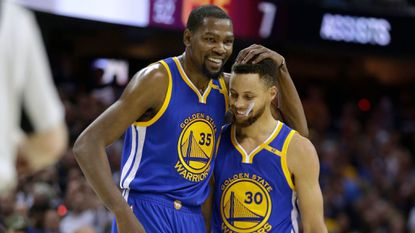 In this file photo from June 9, Golden State Warriors' Kevin Durant, left, hugs teammate Stephen Curry during the first half of Game 4 of the NBA Finals against the Cleveland Cavaliers.
