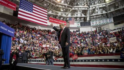President Donald Trump waves after speaking at a rally at Resch Center Complex in Green Bay, Wis., Saturday, April 27, 2019.