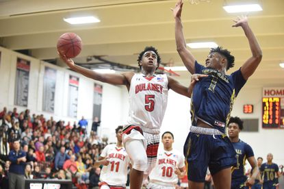 Dulaney's Ryan Conway, left, goes to the hoop against Perry Hall's Laquill Hardnett last February.
