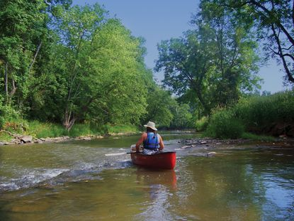 Brad Rogers, Carroll County bureau chief of parks, takes a canoe out on Big Pipe Creek about four miles east of Md. 194 in Keymar. Carroll County will gain 28 miles of water trails with the construction and improvement of four boat launches.