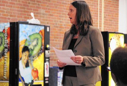 Catonsville resident Cindy Freeman speaks on behalf of the Hillcrest Elementary School PTA at a Southwest Education Advisory Council pre-budget hearing held in the cafeteria at Woodlawn High School Wednesday.