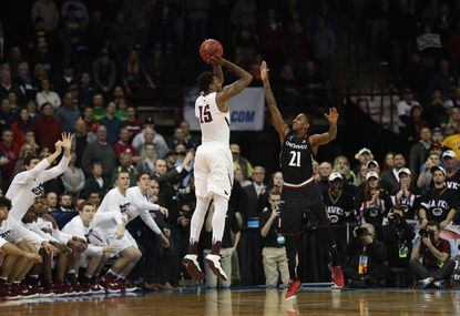 Isaiah Miles of Saint Joseph's scores the game-winning basket over Cincinnati's Farad Cobb in the Hawks 78-76 win in the first round of the NCAA tournament at Spokane Veterans Memorial Arena on March 18, 2016 in Spokane, Washington.