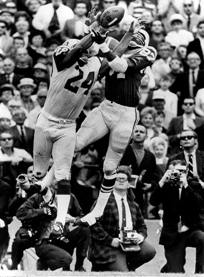 Colts receiver Willie Richardson, right, goes up for an Earl Morrall pass as New York Jets defensive back John Sample defends in the second quarter of Super Bowl III in 1969.