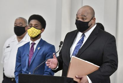 Baltimore City Director of Finance Henry Raymond, right, joined Mayor Brandon Scott and other city officials at a press conference at the War Memorial building to discuss measures to protect homeowners from losing their homes as a result of the upcoming tax sale. May 3, 2021. (Amy Davis/Baltimore Sun).