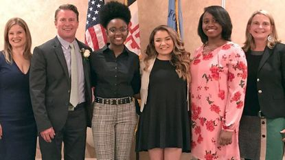 Three Harford County students, from left, Grace Callwood, Claudia Bruce and Shadiamond Kell, were named Women of Tomorrow for 2019 Wednesday. They are with Amber Shrodes, director of community services, County Executive Barry Glassman and Commission for Women Chair Mary Hastler.