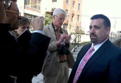 Defense attorney Jason Ehrenberg talks to reporters after a judge found his client, Midshipman Joshua Tate, not guilty of sexually assaulting a fellow midshipman at an off-campus party nearly two years ago.