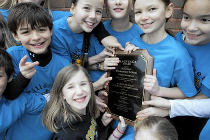 James Roberson, left, 10, Phoebe Rosenbloom, bottom, 9, Lydia Lesnevich, 11, Meg Schumacher, 11, Lilly Queeney, 10 and Sara Baunoch, right, 11, hold the 2014 Black Saga statewide competition award the Hillcrest Elementary School team won. The annual Black Saga competition begins this week.