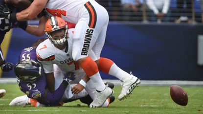 The Ravens' Terrell Suggs (#55) sacks Browns quarterback DeShone Kizer (#7) and causes him to fumble the ball in the first quarter in their matchup in September. Ravens' Matthew Judon recovered the ball for a turnover.
