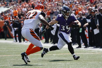 Ravens running back Danny Woodhead runs the ball against Bengals cornerback William Jackson in the first quarter Sunday at Paul Brown Stadium in Cincinnati. He later left with a hamstring injury.