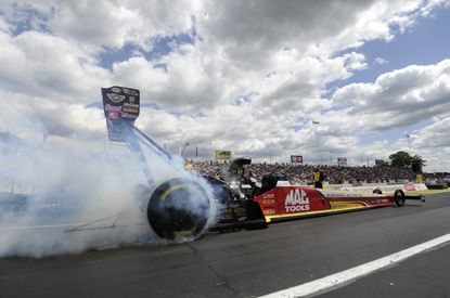 Top Fuel driver Doug Kalitta secures the No. 1 qualifying position in his Mac Tools dragster at the 45th annual Toyota NHRA Summernationals on May 31.