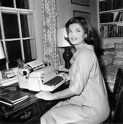 "FILE - In this Oct. 5, 1960 file photo, Jacqueline Kennedy poses at her typewriter where she writes her weekly ""Candidate's Wife"" column in her Georgetown home in Washington. President John F. Kennedy openly scorned the notion of Vice President Lyndon Baines Johnson succeeding him in office, according to a book of newly released interviews with his widow, former first lady Jacqueline Kennedy. (AP Photo/File)"