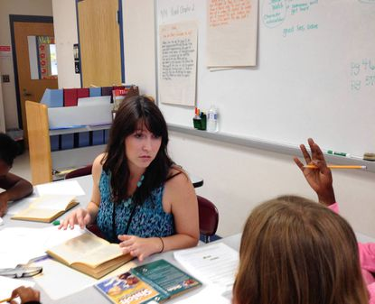 """Amanda Ward, a fourth grade teacher at Marley Elementary School in Glen Burnie, talks to students about the book, """"Shiloh"""" by Phyllis Reynolds Naylor."""