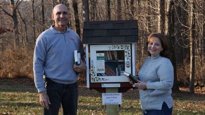 Tonas and Maureen Halil pose with their free little library.