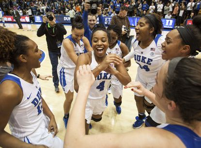 Duke's Lexie Brown celebrates with her teammates following a victory in an NCAA college basketball game against South Carolina in Durham, N.C., Sunday, Dec. 4, 2016.
