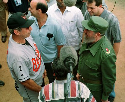 Orioles manager Ray Miller, left, meets with Cuban president Fidel Castro before the game in Havana, Cuba.