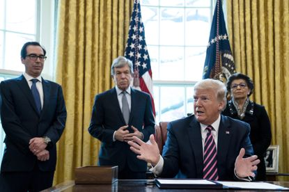 President Donald Trump speaks during a signing ceremony for the Paycheck Protection Program in the Oval Office of the White House in Washington, April 24, 2020. Millions of dollars of Paycheck Protection Program loans went to China-backed businesses in critical sectors, a study found.