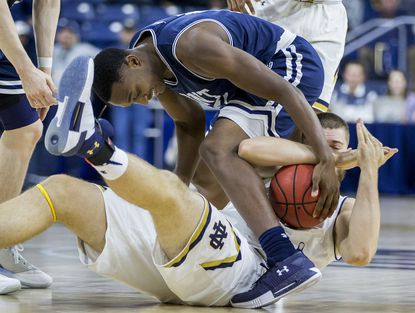 Notre Dame's Martinas Geben, bottom, calls timeout while competing for the ball with Mount St. Mary's Omar Habwe during the second half of a game Monday, Nov. 13, 2017, in South Bend, Ind.
