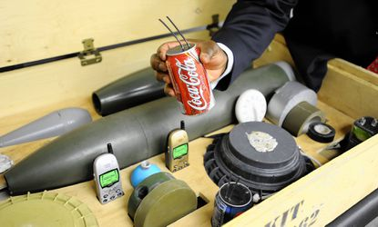 Moses Mingle with I2WD looks at an IED kit that shows the types of things a roadside bomb would be made out of, including soda cans.