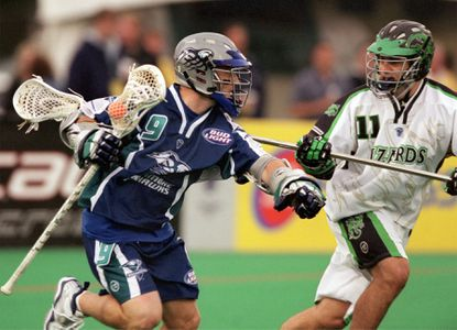 The Baltimore Bayhawks' Mark Millon, left, attacks while the Long Island Lizards' John Gagliardi defends in a 2003 game. The teams would later meet in the championship, which the Lizards won, 15-14 in overtime.