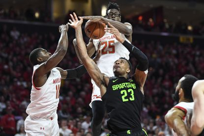 Michigan State's Xavier Tillman Sr. (23) has his shot blocked by Maryland's Jalen Smith (25) during the first half Saturday, Feb. 29, 2020, in College Park.